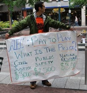 An anti-ALEC protester in Cincinnati. (Mark Haller / Flickr)