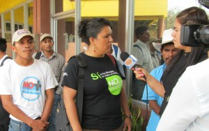 Berta Caceres speaks at a press conference. Photo by Beverly Bell.