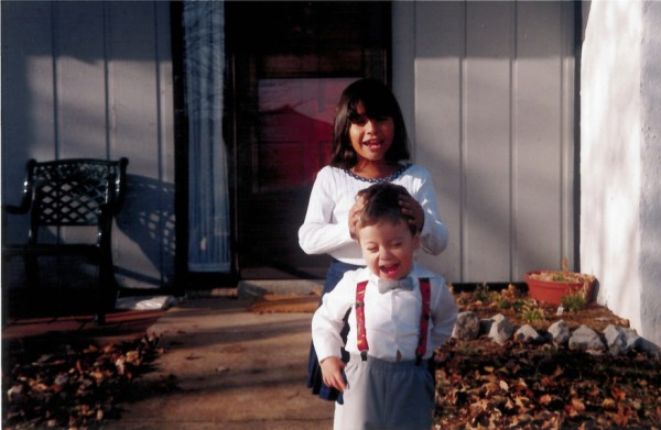 Daniel Valenzuela and his sister in front of their Virginia home.