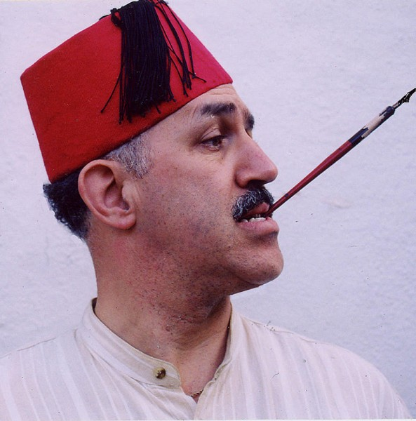 Khail Bendib, in a fez