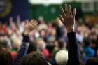 hands_raised_vote_voter_participation